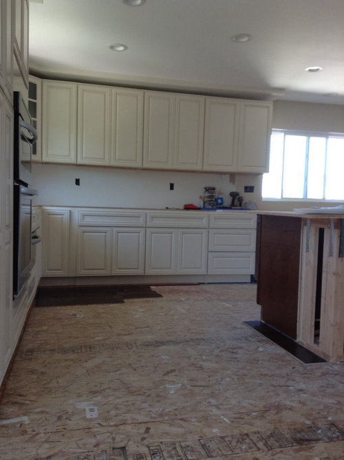 Should I use two different color countertops in my kitchen? on different color trim, different color islands, different color tile, blue color kitchen countertops, different color paint, different color flooring, one color kitchen countertops, different color stone,