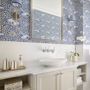 Traditional bathroom in Brisbane with recessed-panel cabinets, beige cabinets, white tile, blue walls, mosaic tile floors, a vessel sink, white floor, white benchtops, a single vanity, a floating vanity and wallpaper.