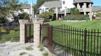 Curved wrought iron fence with gates