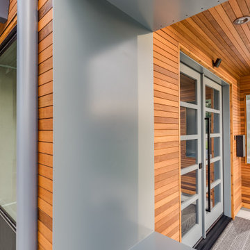 Steel Window Box with Recessed Can Lighting in Modern Western Red Cedar Entry