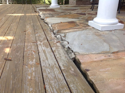 wood deck tie in with the rock patio