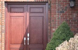 Solid Wood Front Door on Red Brick Home