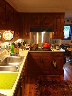 How do I downplay honey oak cabinets on a budget??