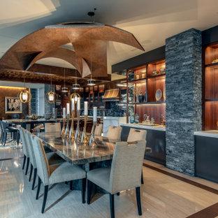 На фото: большая кухня-столовая в современном стиле с бежевыми стенами, полом из керамогранита, фасадом камина из каменной кладки, бежевым полом и деревянным потолком с