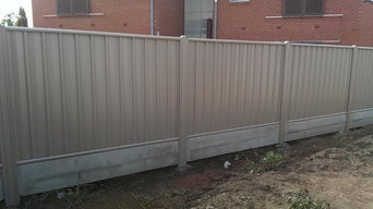 Neetascreen fence with intermediate posts and heavy duty concrete plinths in col