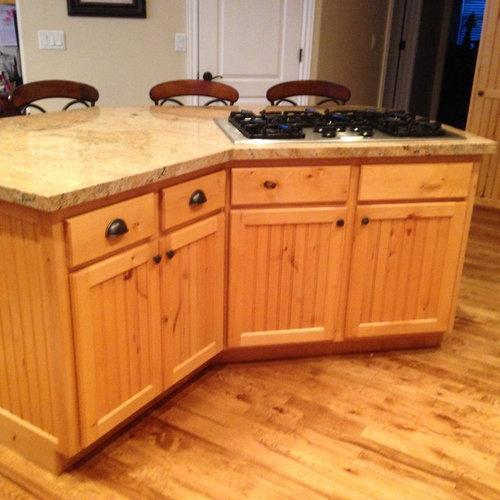 light knotty alder cabinets need an update...white or dark ...