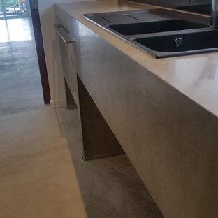 Foto di una cucina industriale con top in cemento