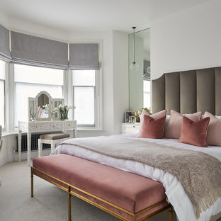 Photo of a large classic bedroom in London.