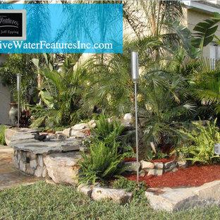 Large island style home design photo in Orlando