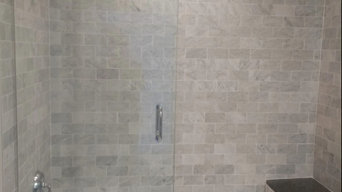 Midtown high-rise marble tile bathroom.