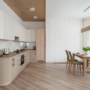 Пример оригинального дизайна: кухня в современном стиле в частном доме