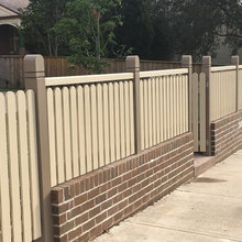 decorative picket fence and retaining wall