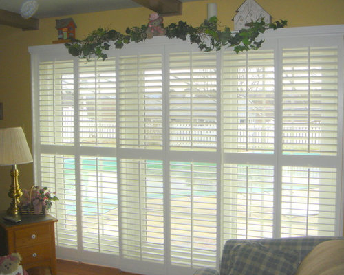 plantation shutters on a sliding glass door opened the louver shop photos products