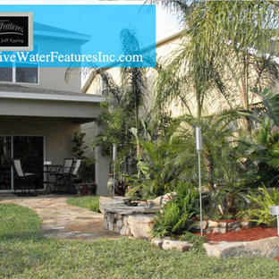 Example of a large island style home design design in Orlando