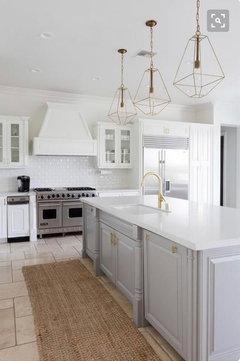 All white kitchen VS White kitchen with gray Island on