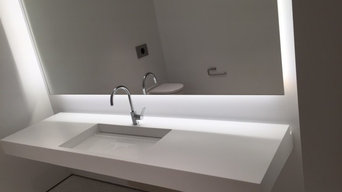 Floating Krion vanity in Snow White Krion with single slope hidden drain