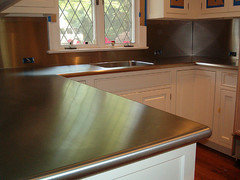 I M Not Sure On The Last One Though Perhaps That S Gray Quartz Countertops With Stainless Tiles And Sink Sloppy Googling
