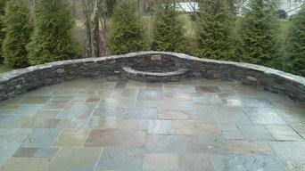Bluestone patio with firepit and sitting wall