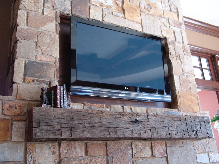 Rustic Mantle in Stone Fireplace with Recessed Area for TV