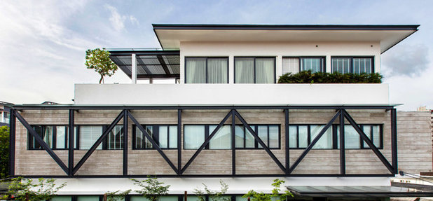 Tropical Exterior by Aamer Architects