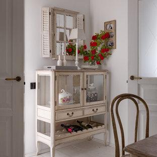 На фото: маленькая кухня-столовая в скандинавском стиле с белыми стенами, деревянным полом, двусторонним камином, фасадом камина из плитки, белым полом, кессонным потолком и стенами из вагонки с