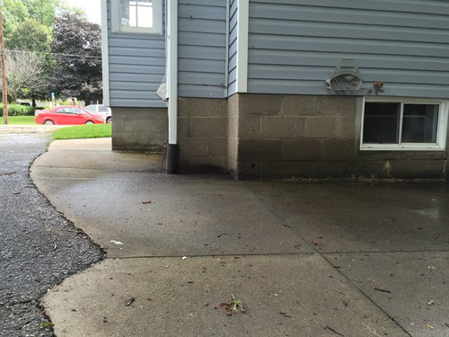 Sloped concrete next to foundation  Need ideas for repair