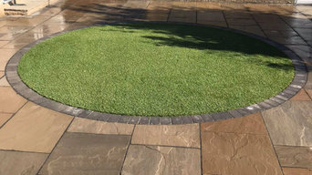 Sandstone slab back garden with Lawn  feature