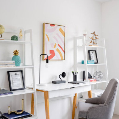 Example of a mid-century modern home office design in Orange County