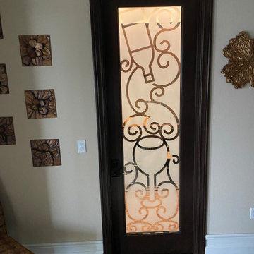 Reverse etched glass door