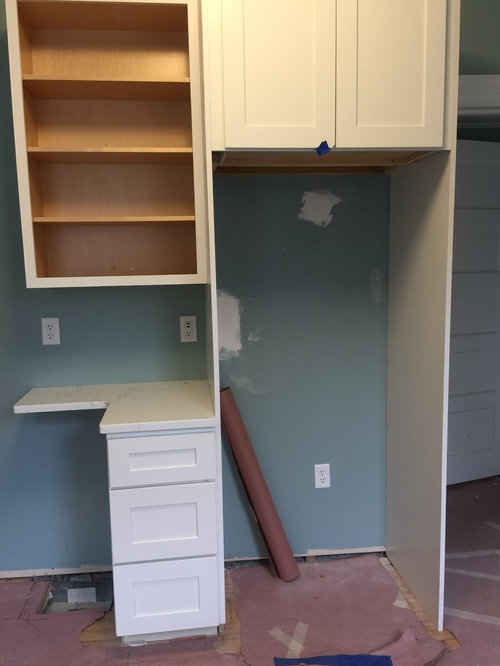 Does Anyone Have A Suggestion On How To Trim Out This Base Cabinet So That It Looks Level Floor Slopes Lot