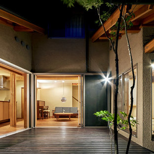 Design ideas for an asian courtyard deck in Other with no cover.