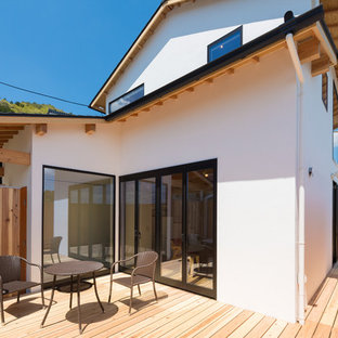 Inspiration for a scandinavian deck remodel in Kyoto with no cover