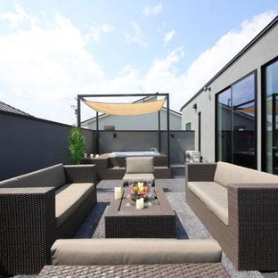 Foto di una terrazza moderna sul tetto con nessuna copertura