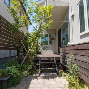 Inspiration for a scandinavian side yard outdoor kitchen deck remodel in Other