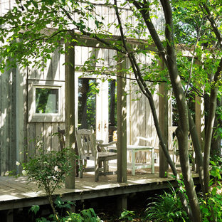 Inspiration for an asian deck in Other with an awning.