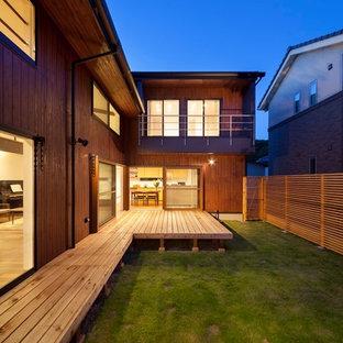 薪ストーブ囲む コの字型の家