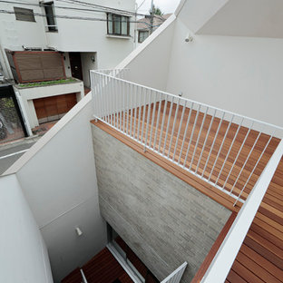 Deck skirting - mid-sized modern rooftop deck skirting idea in Tokyo with a roof extension