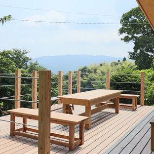 他の地域のコンテンポラリースタイルのおしゃれな裏庭のデッキ (日よけなし) の写真