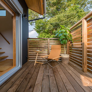Photo of a small scandi terrace and balcony in Other with a roof extension.