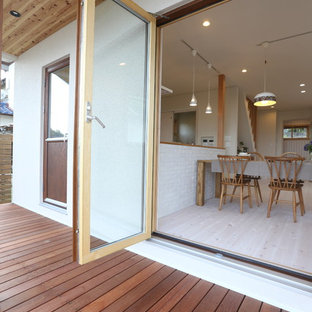Example of a danish backyard deck design in Other with no cover