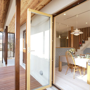 Inspiration for a scandi side terrace and balcony in Other with a roof extension.