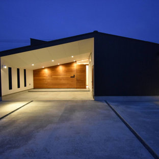 Inspiration for a mid-sized industrial attached two-car porte cochere remodel in Other