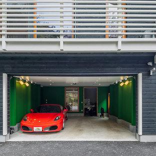 Idées déco pour un garage pour deux voitures attenant scandinave.