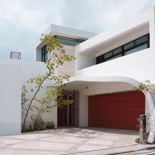 Foto på en orientalisk tillbyggd garage och förråd