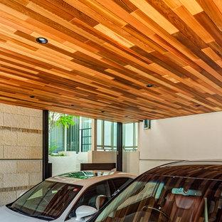 Inredning av en modern tillbyggd tvåbils garage och förråd