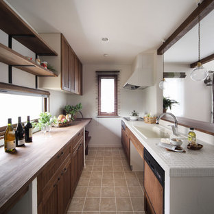 Photo of a contemporary galley kitchen in Other with a drop-in sink, recessed-panel cabinets, dark wood cabinets, tile benchtops and white appliances.