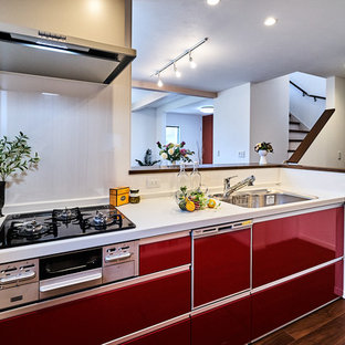 Design ideas for a modern kitchen in Other with red cabinets, plywood flooring, brown floors and brown worktops.
