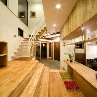 東京23区のインダストリアルスタイルのおしゃれなI型キッチン (ステンレスカウンター、緑のキッチンパネル) の写真