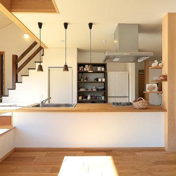 オーダーキッチンと土間と薪ストーブの家