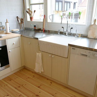This is an example of a mid-sized traditional l-shaped kitchen in Osaka with a farmhouse sink, flat-panel cabinets, white cabinets, stainless steel benchtops, white appliances, no island and orange benchtop.